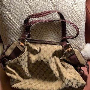 Gucci bag with braided leather handles.